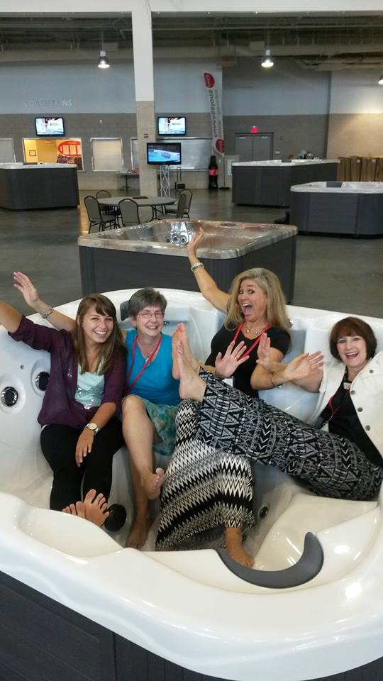 Exploring a hot tub expo with fellow ASID board members and Interior Design Industry professionals.