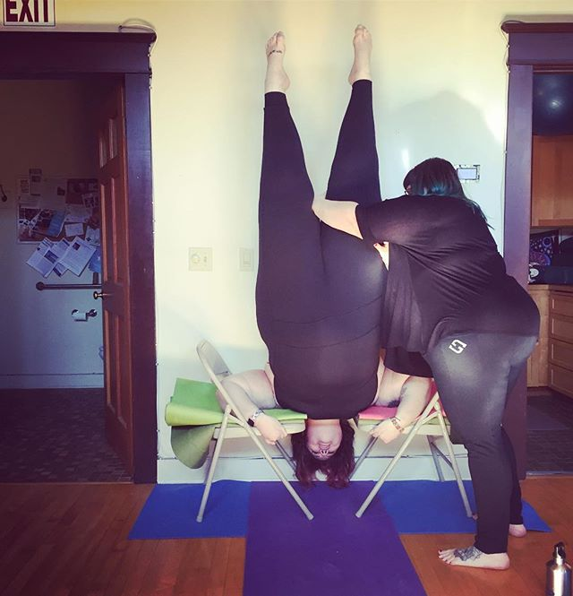 "First and foremost I wanna share this while also sharing the reality. I have never been fully upside down in my yoga practice. I have feared inverting not only because of my body size (aka size bias in the yoga industry/ the cultural narrative), but also because no teacher has ever said ""let's try it, I'll spot you"", I've also not had much contact with other fat teachers. When @amberkarnesofficial said ""let's try it"" I wanted to cry, run, jump for joy, then die in a hole. My good fatty brain took over, and I had to stop.... I had to meet myself, reassure myself, and remind myself that no matter if I got my legs up or didn't... who i am and my inherent value doesn't change. . . . So I got up there! My fat 6'3 dope body went into a supportive headstand! I feel proud not because I did a yoga inversion, but because I stayed with myself through the entire experience of it. I didn't dissociate, I stayed with this sweet body. I stayed with my experience, and I flipped my body upside down. . . . To you @amberkarnesofficial I thank you, because you also stayed with me the entire experience. So if you need permission to try something scary here it is.... These bodies are worth staying for. . . . . #joyfulmovement #yoga #bodyloveyoga #bodypositiveyoga #magic #fatcommunity #fatyogababes #fatandfree #youcansitwithus"