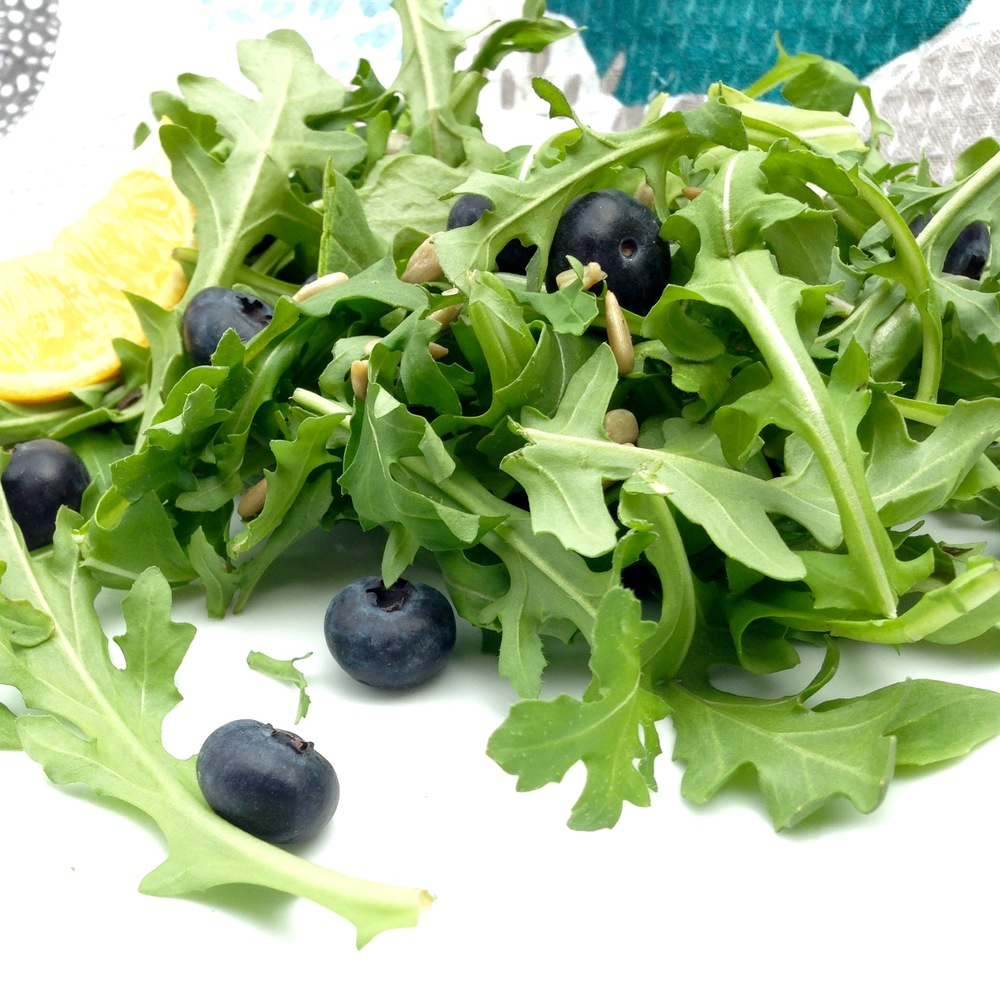 Plump, juicy blueberries, spicy arugula and sweet meyer lemon come together to make the simplest and most delicious springtime salad.