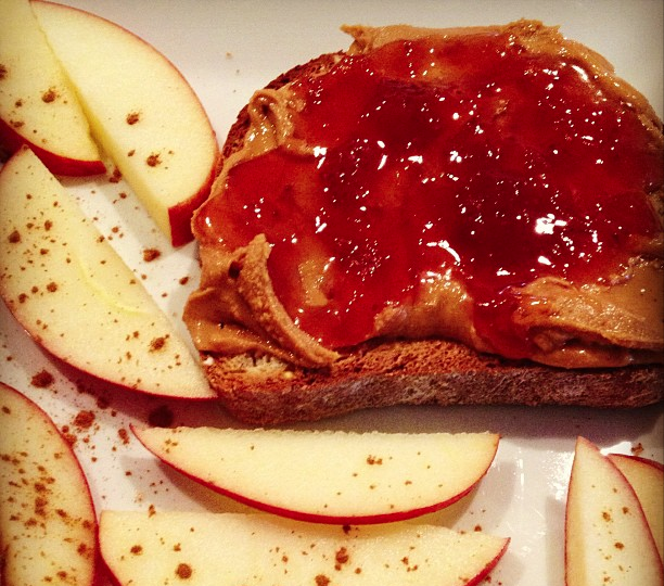 Gluten free toast, creamy organic peanut butter and a smear of strawberry peach jam. Apples just because.