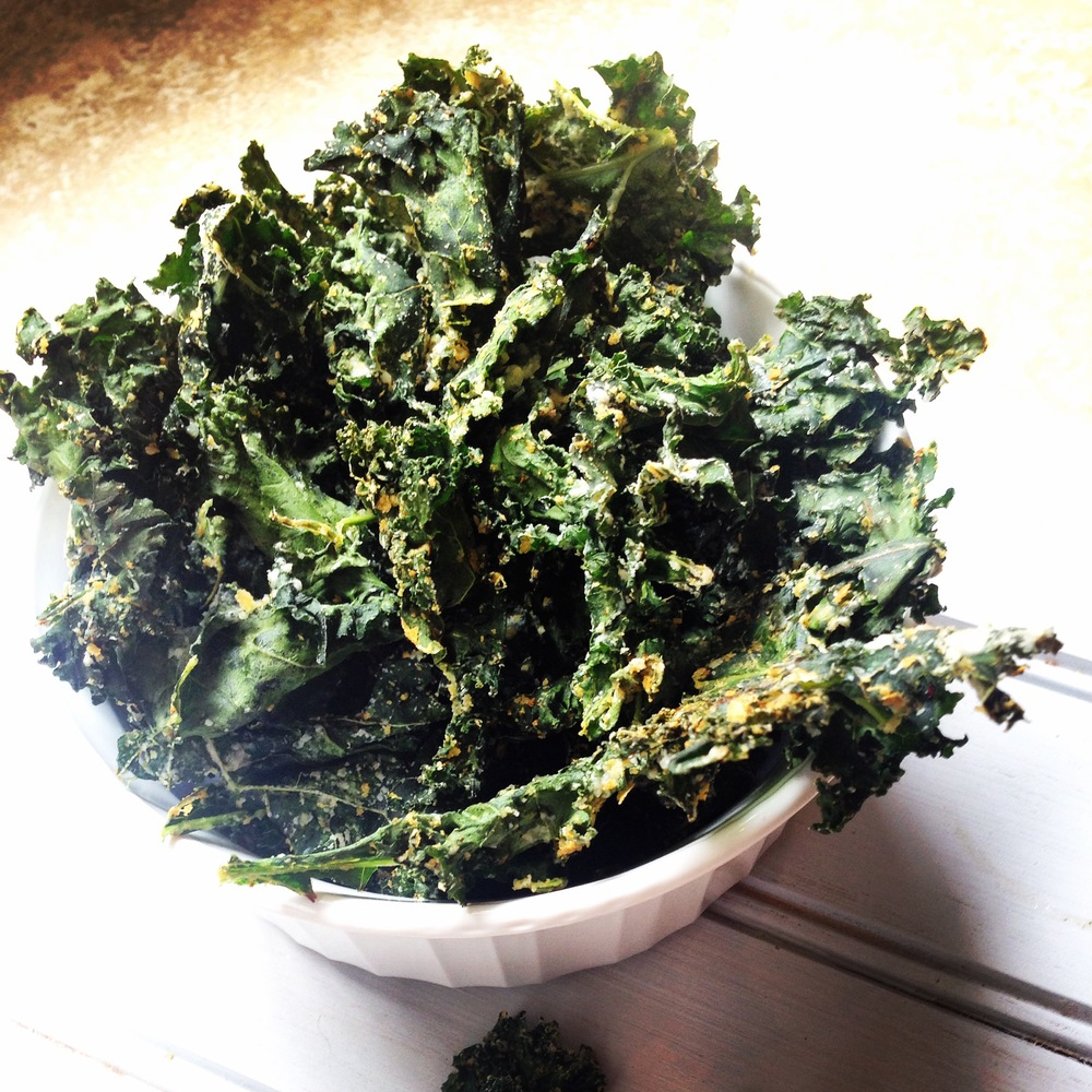 These vegan cheezy kale chips have the perfect amount of spice and satisfying crunch to keep you on track to your healthiest self this summer.