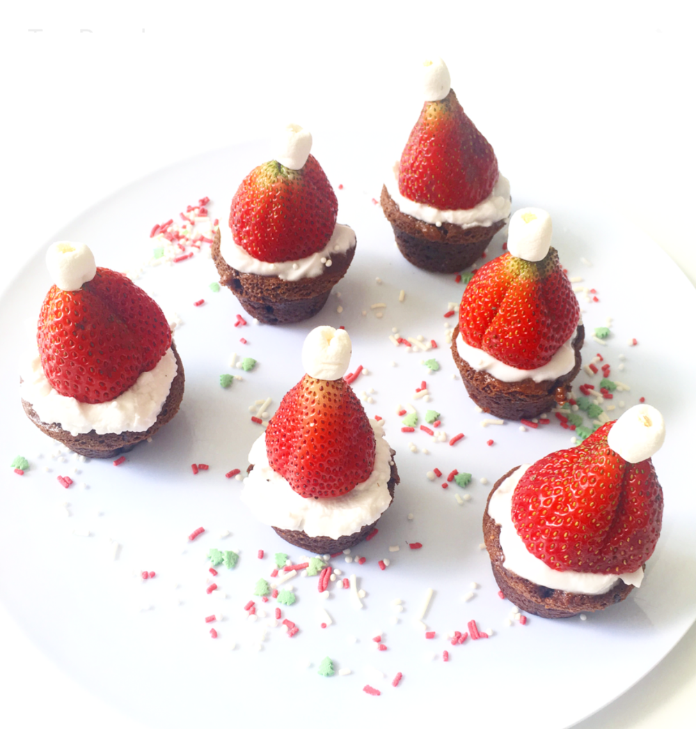 Vegan, gluten-free and grain-free Santa Hat Brownie Bites. Made with whole food, natural and plant-based ingredients, these treats are simply the best way to spread Christmas cheer!