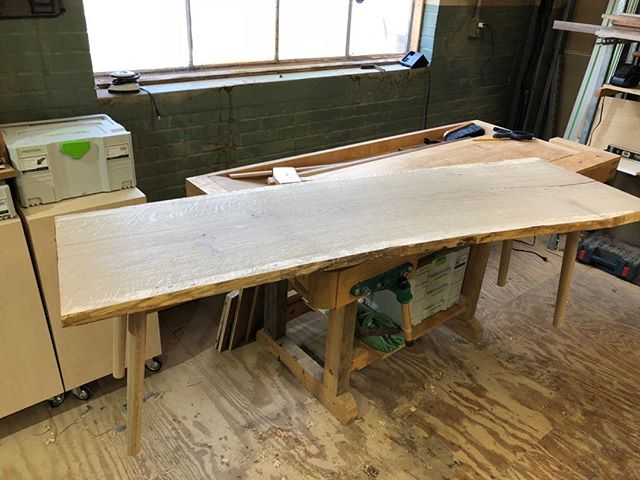 A live-edge bench, with mid-century modern leanings starts to take shape in the shop