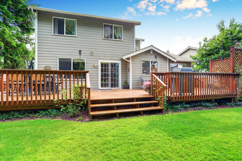 Back yard house exterior with spacious wooden deck