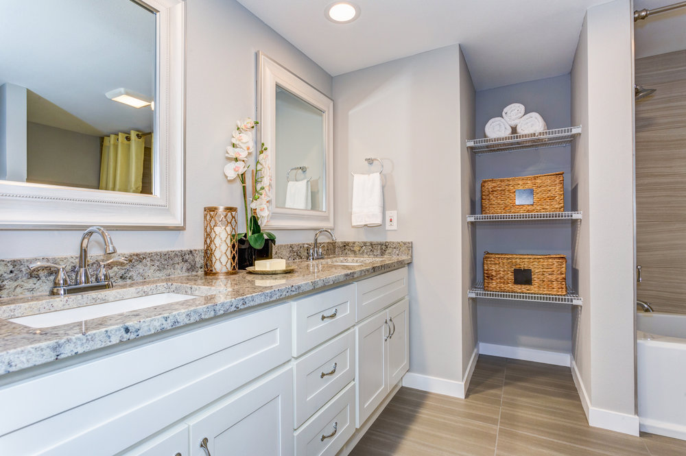 Elegant bathroom with long white vanity cabinet