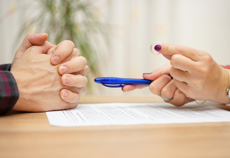 Mutual consent how your divorce really can be quicker and easier in husband and wife looking over divorce papers solutioingenieria Gallery