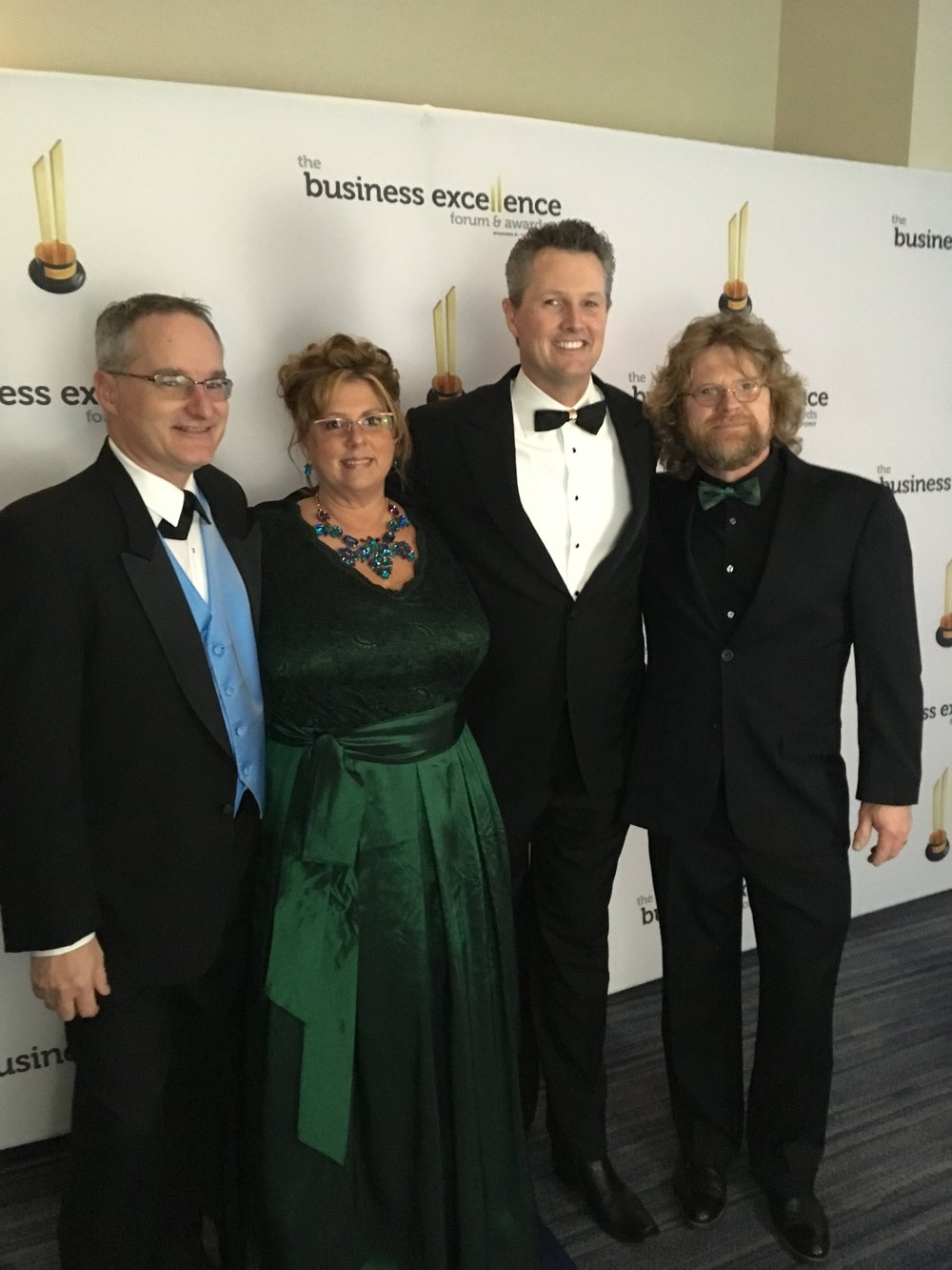 Tim (far right) & Liz (second from left) Koch, proprietors of The Mad Hatter and finalists at the 2017 Business Excellence Forum