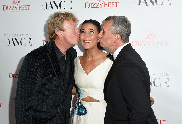 Nigel Lythgoe and Adam Shankman with actress Emmanuelle Chriqui