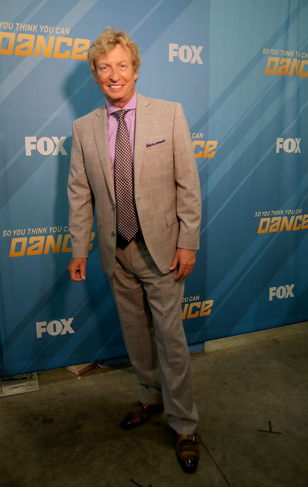 Nigel Lythgoe    Suit: Tallia Orange  Shirt: Ralph Lauren Purple Label  Tie: Tom Ford  Shoes: Max Verre    Styled by Miles Siggins
