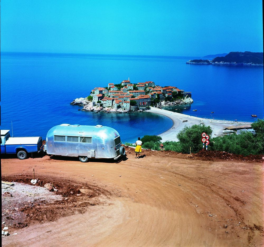 People who travel via Airstream get to see more of the world than folks who fly or take the train. Here we see one traveler looking at beautiful Sveti Stefan, an island connected by causeway to the mainland in Montenegro about four miles southeast of Budva.