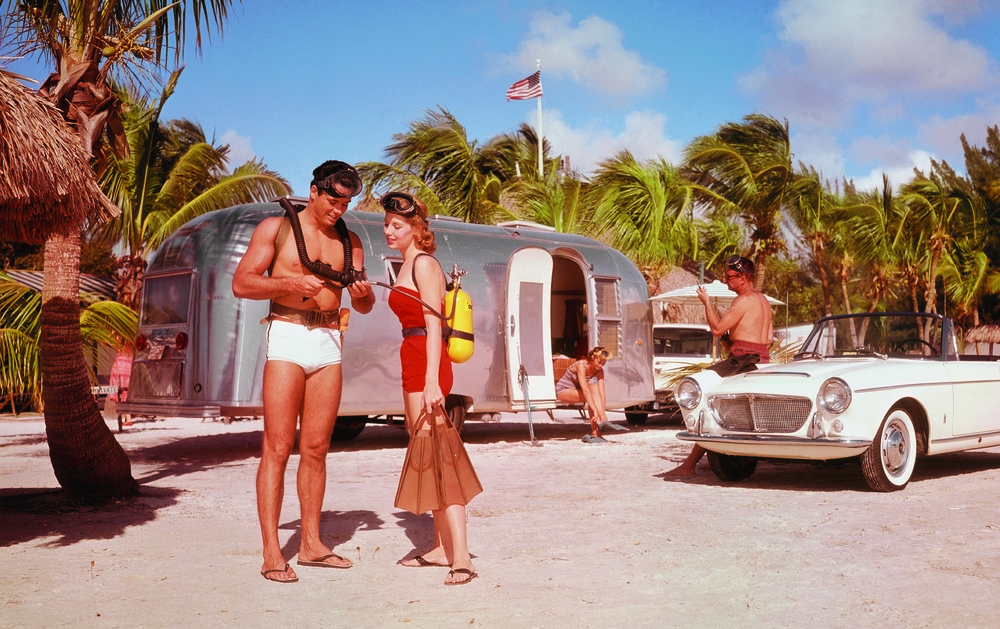 For those with less time on their hands a quick trip to Florida was always a easy choice to make. Imagine parking your trailer right on the beach,with sand and palm trees all around you. The white sports car barely visible to the right is an early 1960's Fiat.
