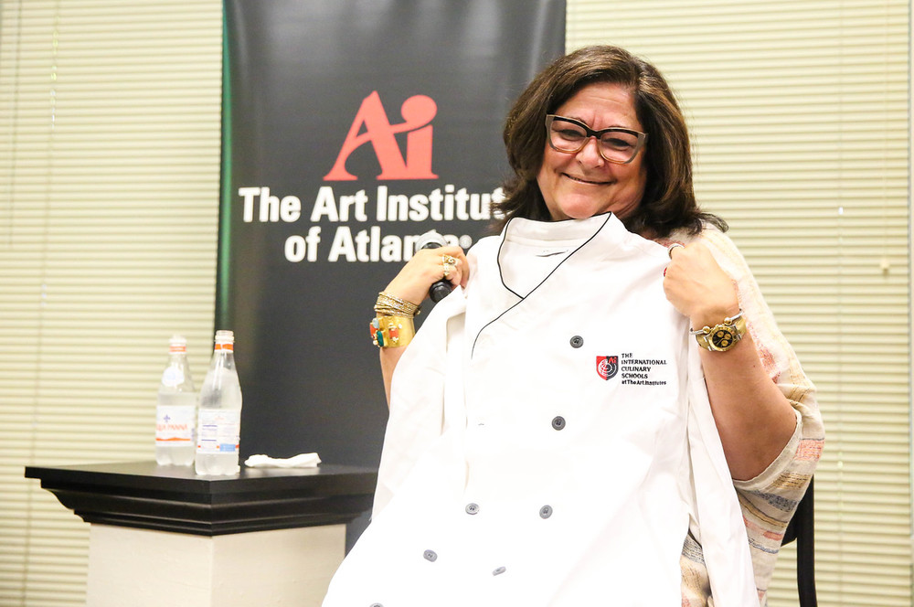 Fern revealed that she has a joy for cooking so she was gifted with an official Art Institute of Atlanta chef's jacket.