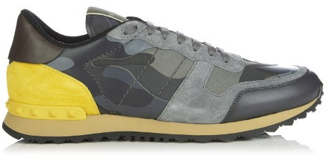 This season Valentino's Rockrunner low-top trainers are given a brightly hued accent. They're crafted from a tonal-grey camouflage-print canvas that's offset with a yellow suede heel panel - note the Rockstud motif that lines the back also. They run true to size.