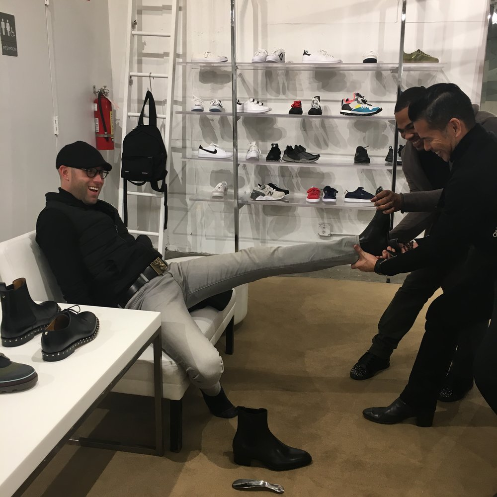 Alex needed assistance taking off the Saint Laurent boots he was trying on at Jeffrey.