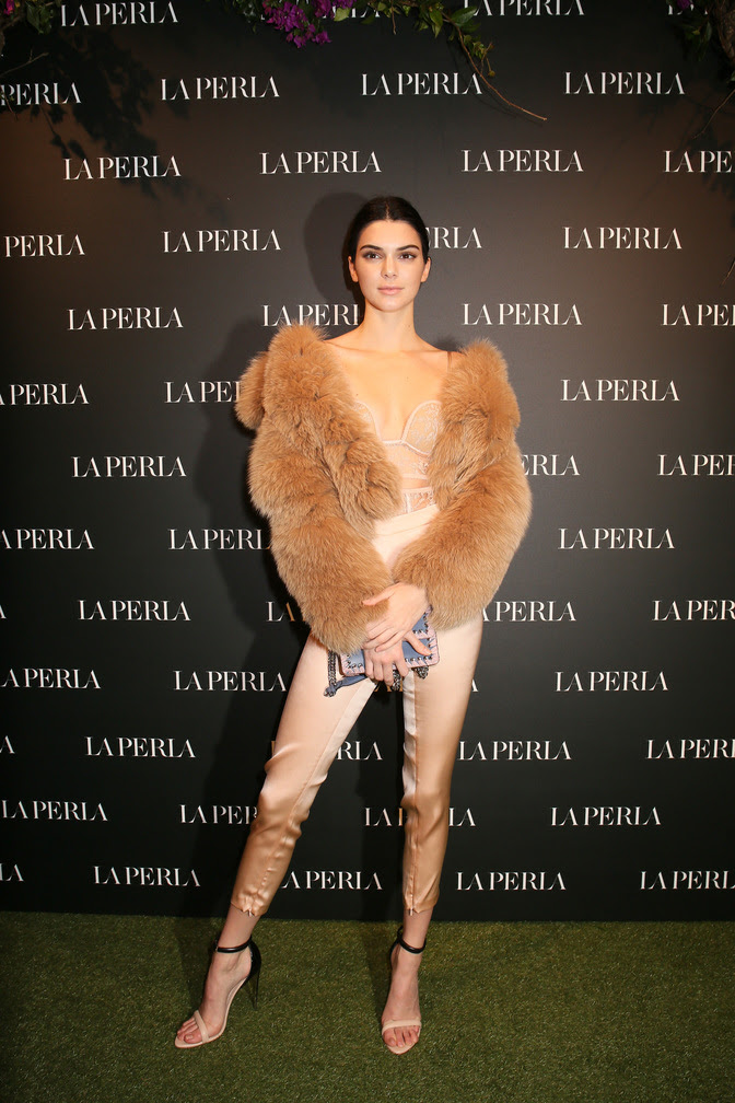 Kendall Jenner wearing the La Perla SS17 Autografo Bodysuit in Blush with matching SS17 bi-stretch silk skinny pant and two-tone calfskin sandals.