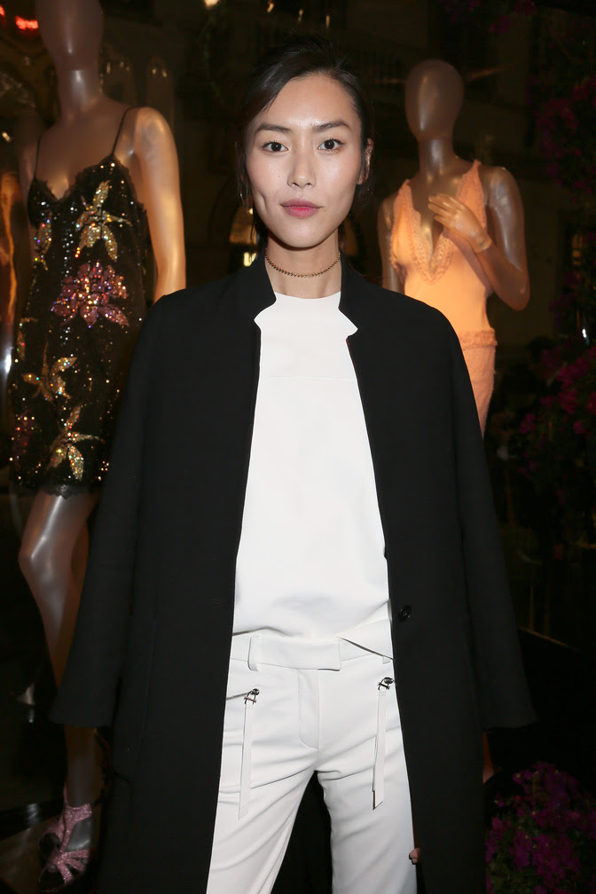 Liu Wen attends the La Perla Milan Fashion Week unveiling of the new Montenapoleone boutique.