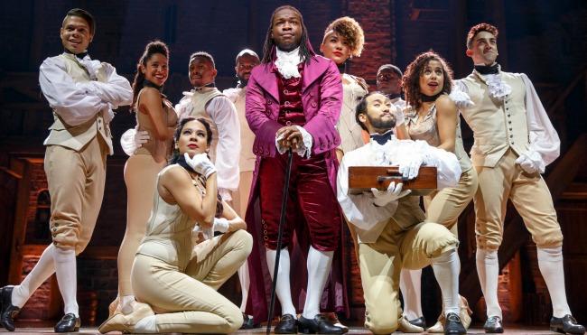 "Chris De'Sean Lee as Thomas Jefferson (center, he also plays the Marquis de Lafayette) and the ""Hamilton"" company. Photo: Joan Marcus"