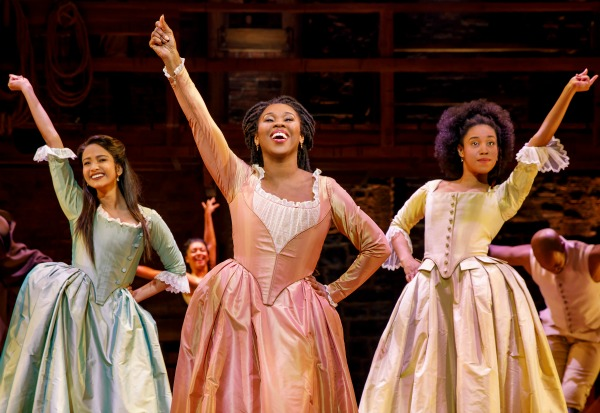 The Schuyler sisters — Eliza, Angelica and Peggy — sneak into New York City to watch the men at work.