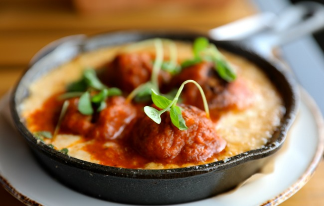 The Spanish-style tomato-braised pork meatballs at New Realm. Photo: David Danzig