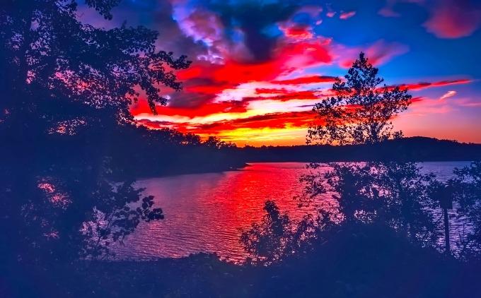 Lake Lanier — fun by day, fiery sunsets by night.