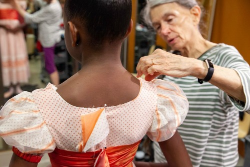 A costume fitting with designer Sandra Woodall. Photo: Kim Kenney