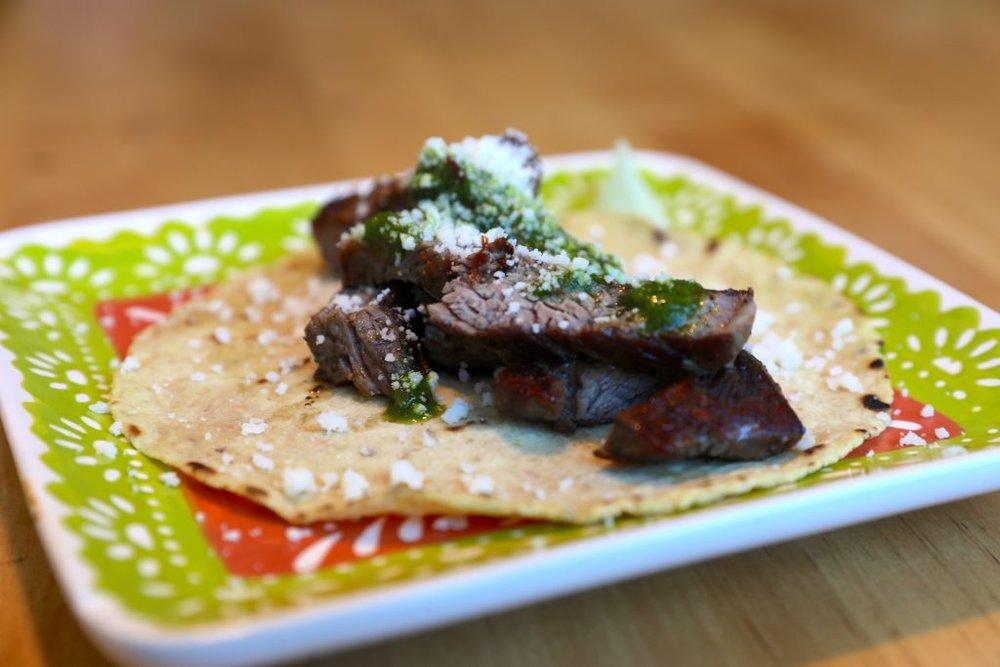 Skirt steak taco with chimichurri garlic aioli and cotija cheese and Tuza Taco. Photo by David Danzig.