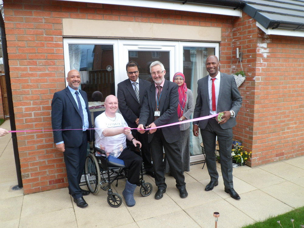 Cllr Richard Lewis cuts the ribbon to officially open Rocheford Court, assisted (from left to right) by Unity chief executive Ali Akbor, resident Jonathan Griffiths, Unity board members Naseer Ahmed and Shazia Khan, and Unity regeneration director Wayne Noteman