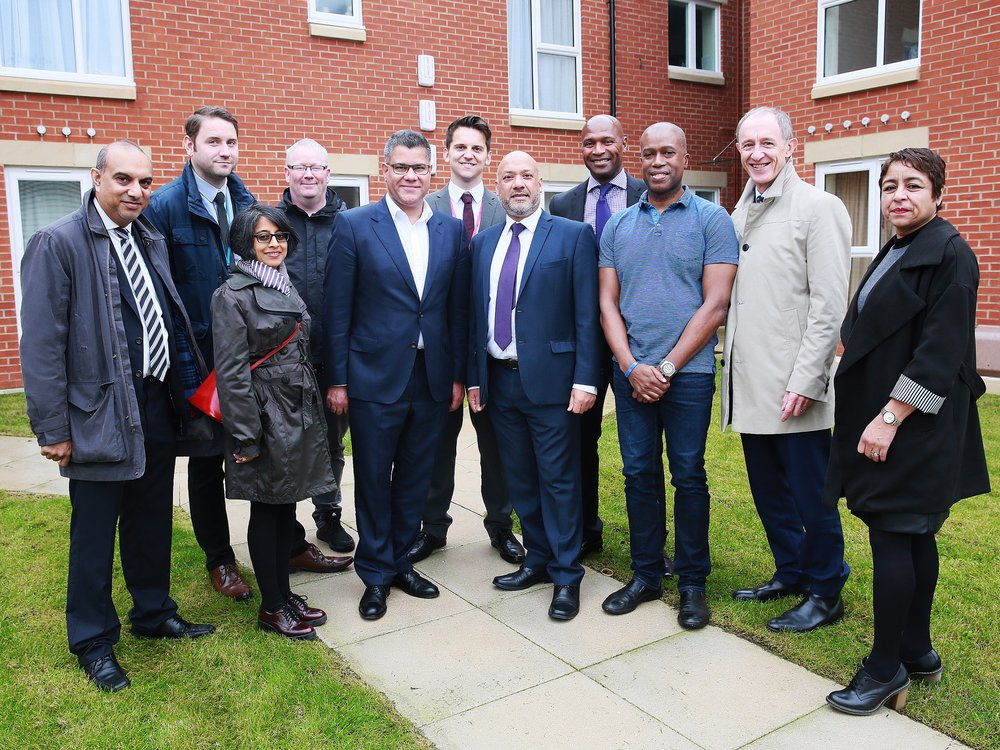 Housing and Planning Minister Alok Sharma (fifth from left) is joined by resident Ian Bailey (third from right), Unity chief executive Ali Akbor (centre), Unity board members and other partners at the Holborn Court affordable homes development in Little London, Leeds