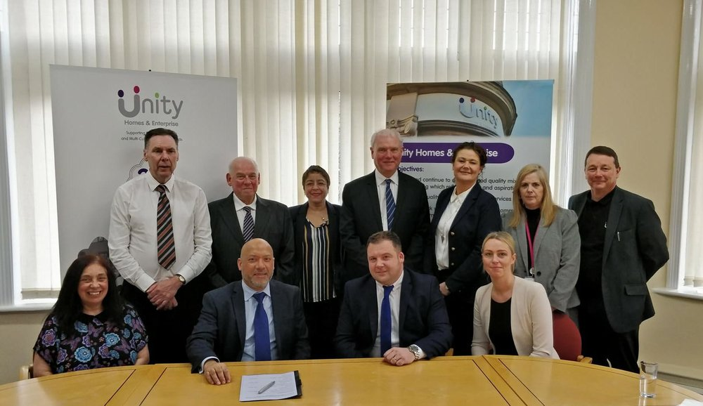 Ali Akbor (front, second from left) and Gary Thewlis (front, second from right) with staff from Unity Homes and Enterprise and GTD Painting and Property Maintenance.  Also included are Unity tenant Belinda Letham (front, left) who assisted with the procurement process alongside Adrian Smith (back row, second from left) and Nigel Barr (back row, fourth from right) from consultants Stradia