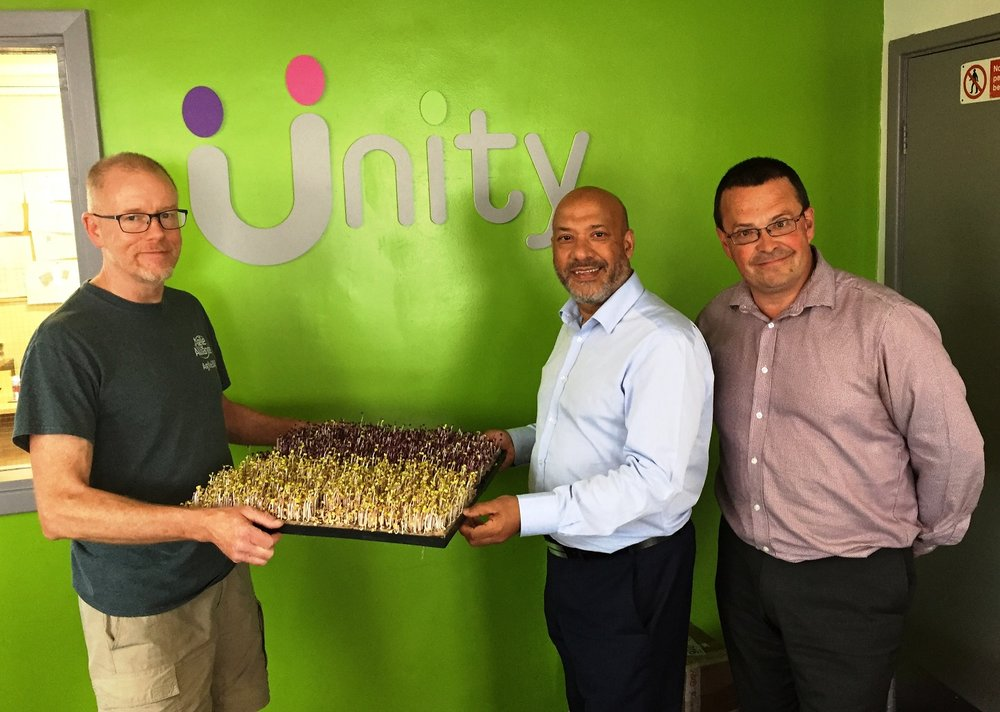From left to right: Growing Better founder and chief executive Rob Moores at Unity Business Centre with Unity Homes and Enterprise chief executive Ali Akbor and Unity Enterprise manager Adrian Green