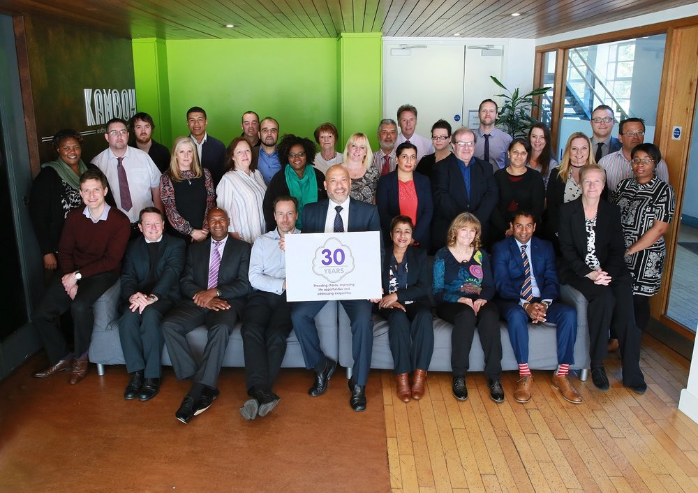 Unity Homes and Enterprise staff celebrate the association's 30th anniversary in 2017