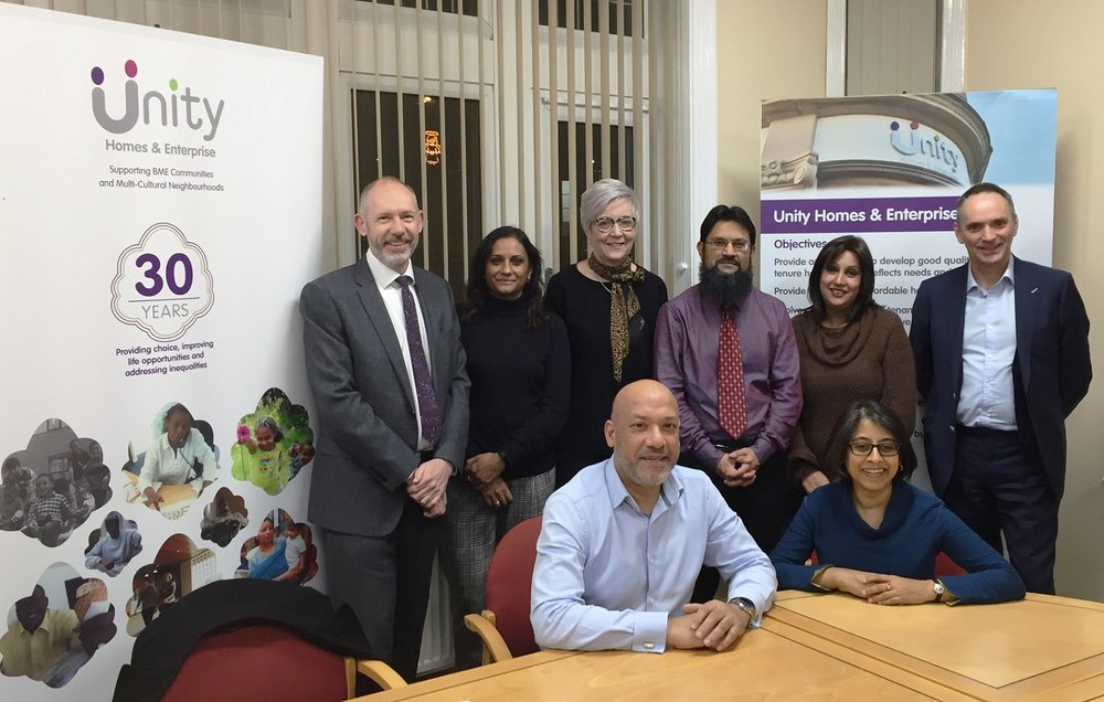 Unity Homes and Enterprise Chair Shruti Bhargava (front right) and Chief Executive Ali Akbor (front left) welcome the new recruits to the association's offices in Leeds