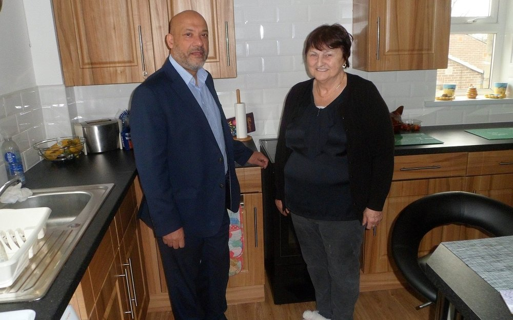 Mrs Mortimer, a Chapel Fold tenant, in her brand-new kitchen with Unity Chief Executive Ali Akbor