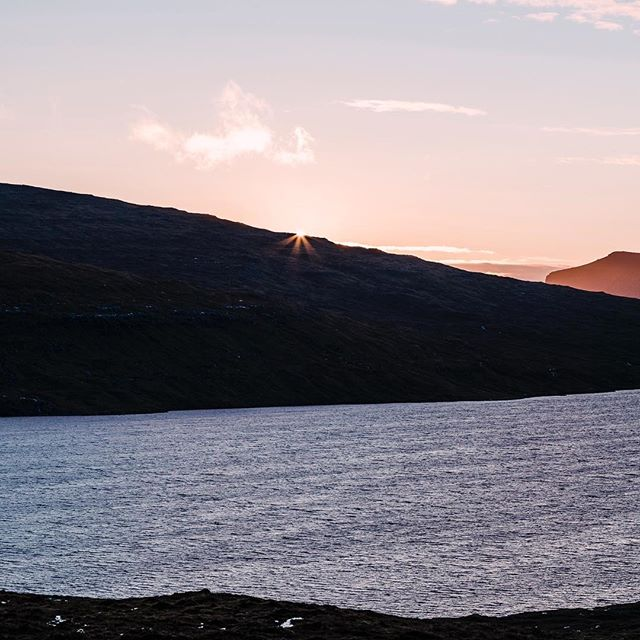 Sunset panorama. Faroe Islands.  View of the sunset with a shimmer of sunlight is simply sublime.