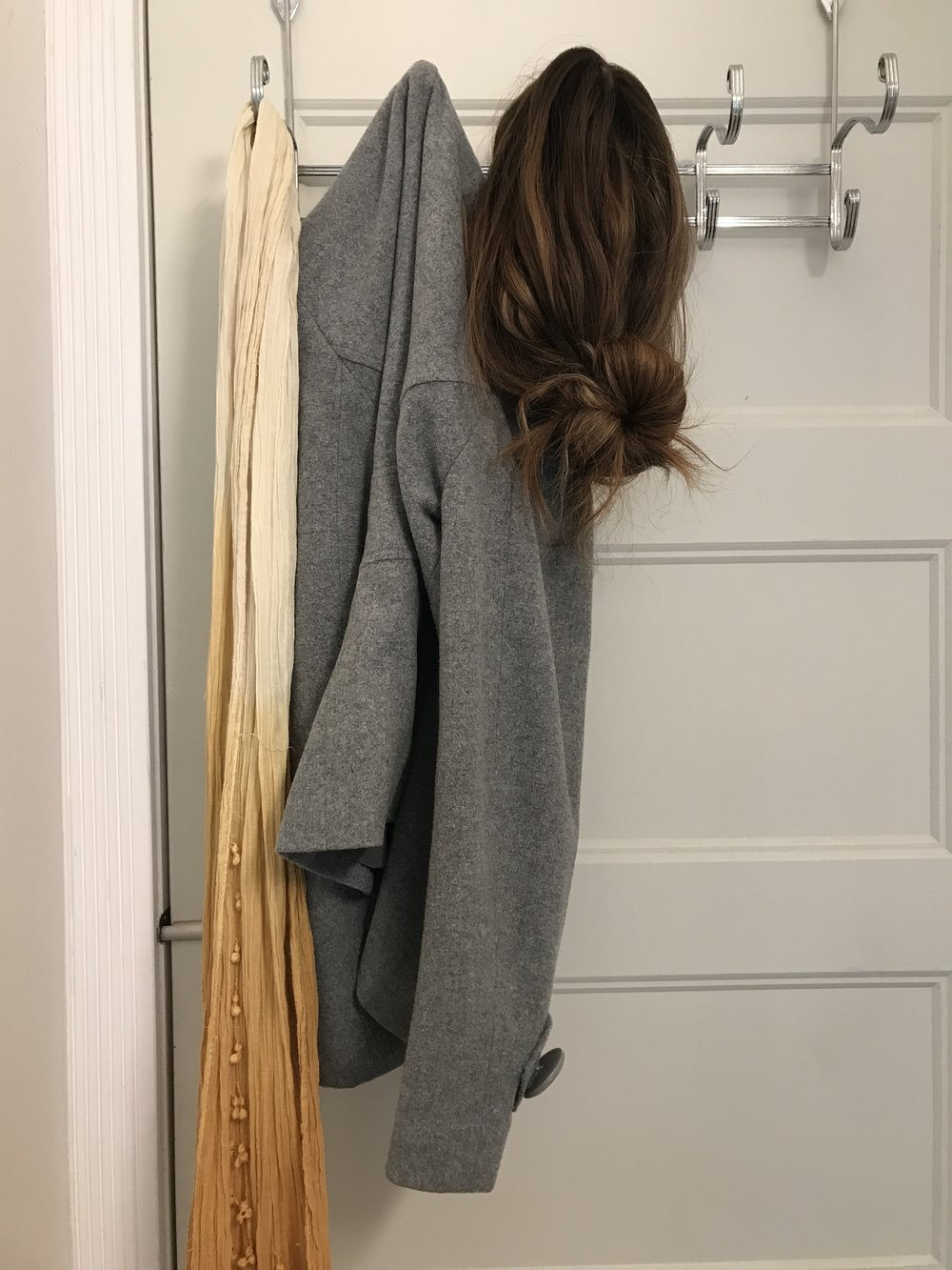 Just hang that hair anywhere, sister. We've been there. Shot of iWig Human Hair wig on the back of a bathroom door just to have it OFF of the head for a moment!