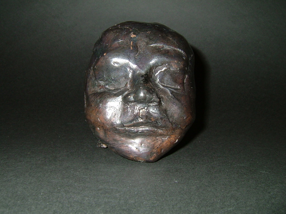"""Day 1""  (2004)  Bronze cast  3.4 in diameter"
