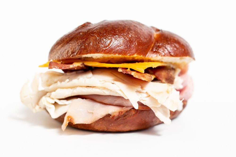 LAFAYETTE CLUB - Smoked ham, roasted turkey, Kunzler bacon, sharp cheddar, mayo, Pilsudski's Sweet-Hot mustard