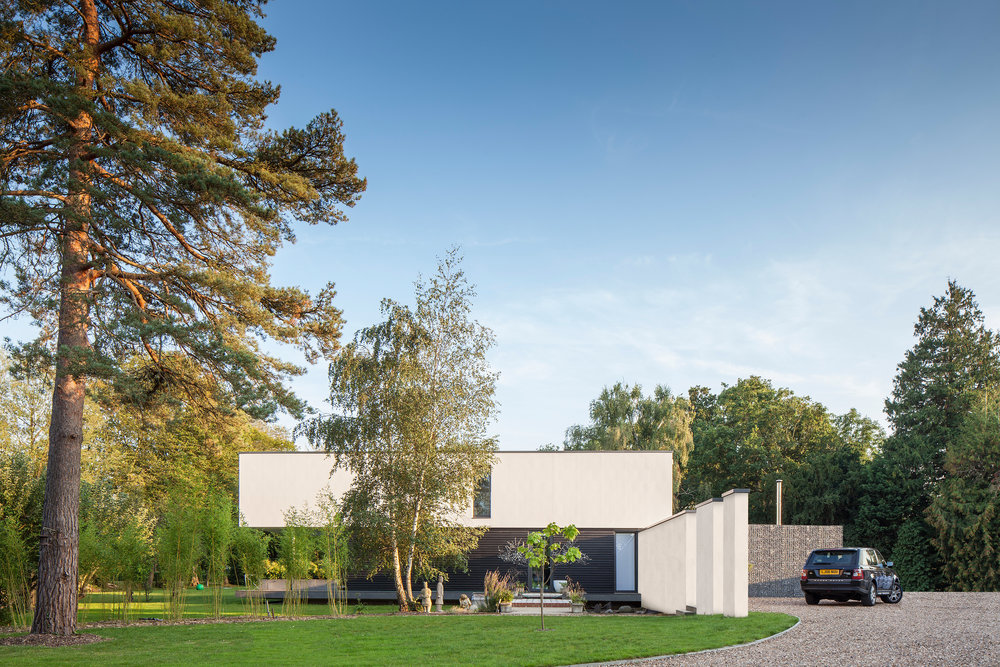 tall-trees-contemporary-white-render-esher-surrey-gabion-modern-architecture