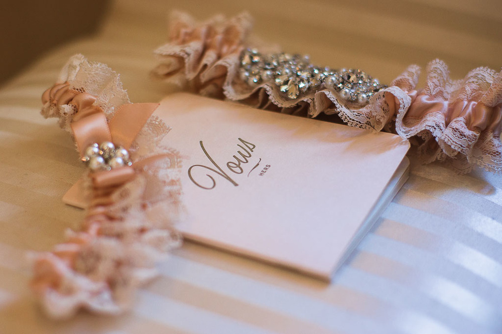 lace pink garter and wedding vow book fayetteville ar wedding photographer