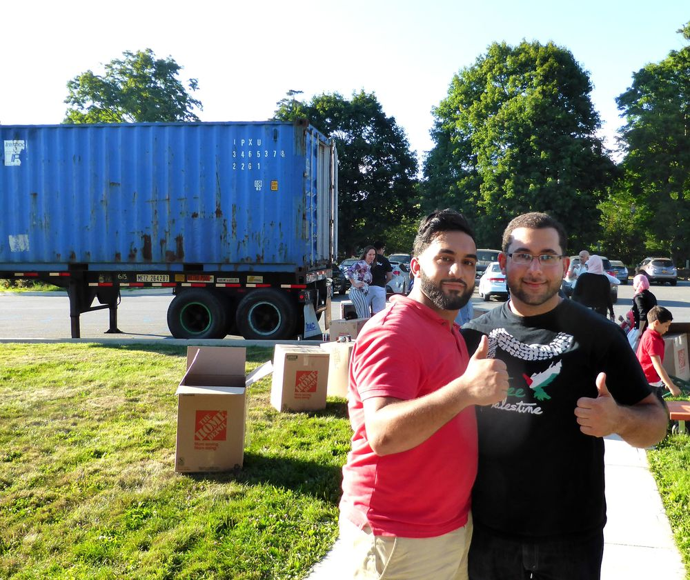 Our New Jersey Coordinator, Adam, and volunteer Ahmed load the shipping container in Mohegan Lake, NY.