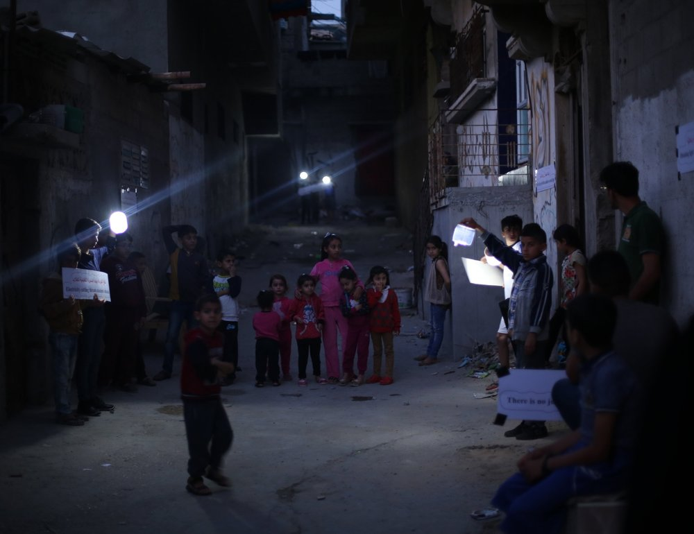 Families gather with their lights together every Wednesday during  Nur al-Amal