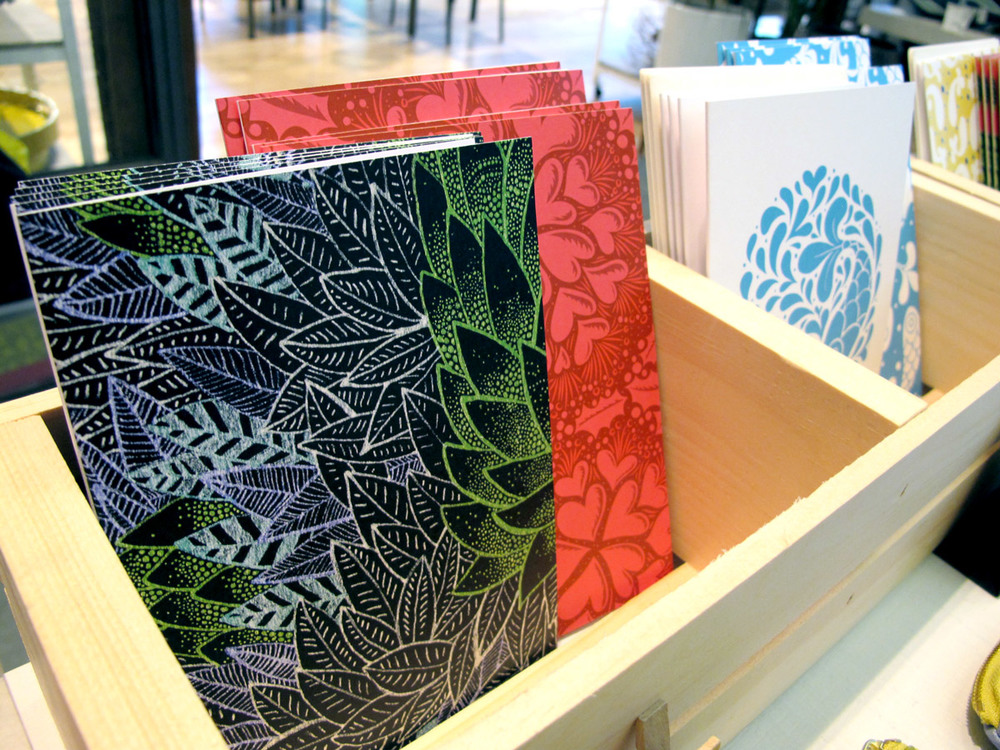 from left to right: Electric Jungle print, Hearts and Holly, Fish Kiss on greeting cards