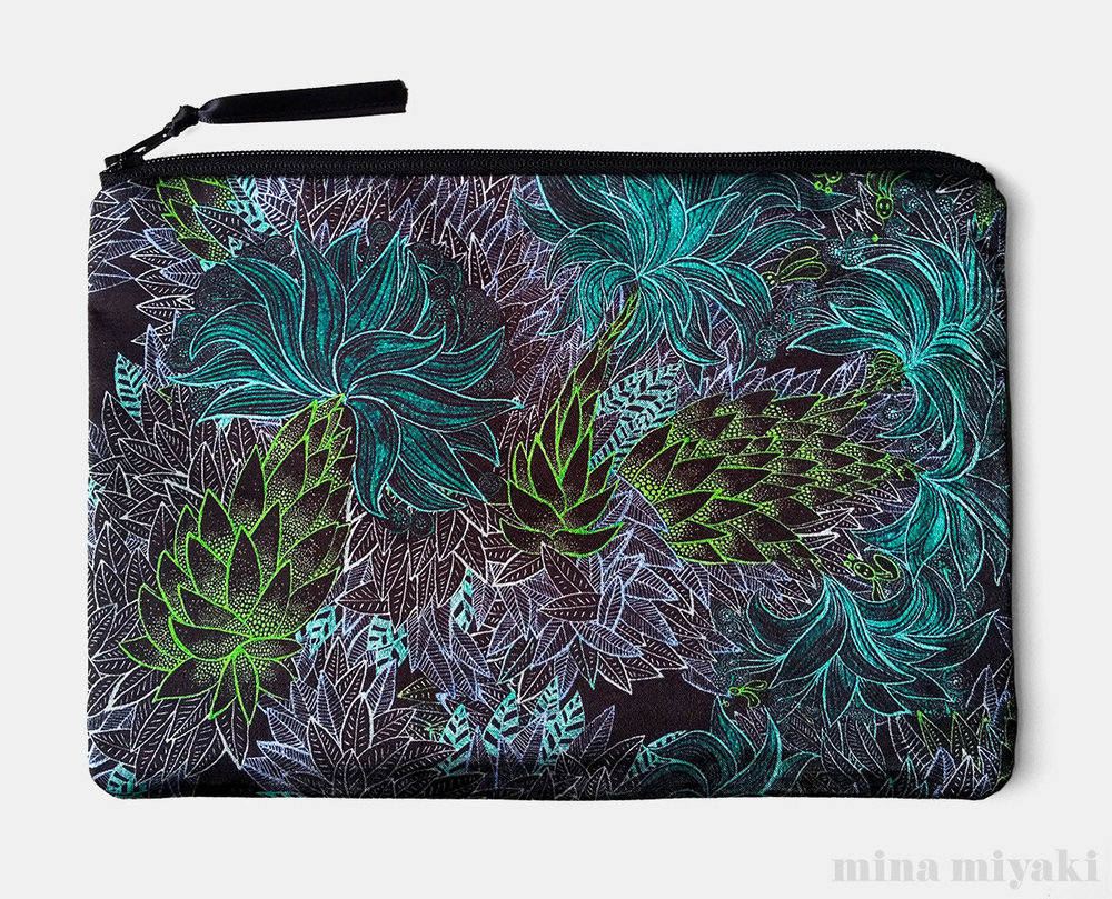 New Electric Jungle Print Pouch $25
