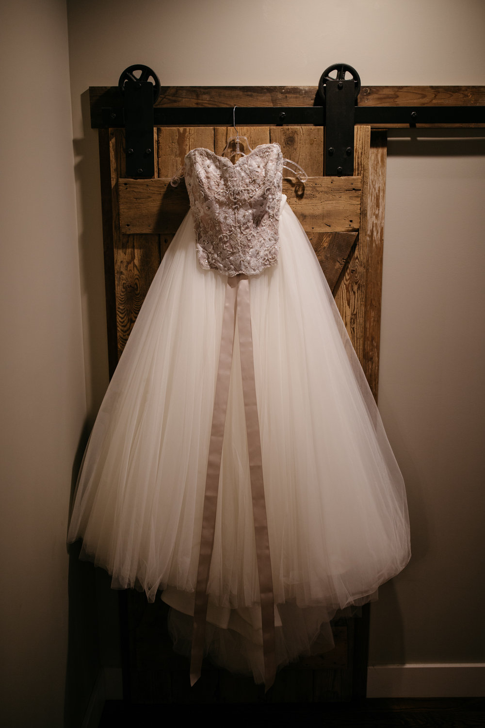 Pink wedding dress hanging in cabin at Grand View Lodge on Gull Lake