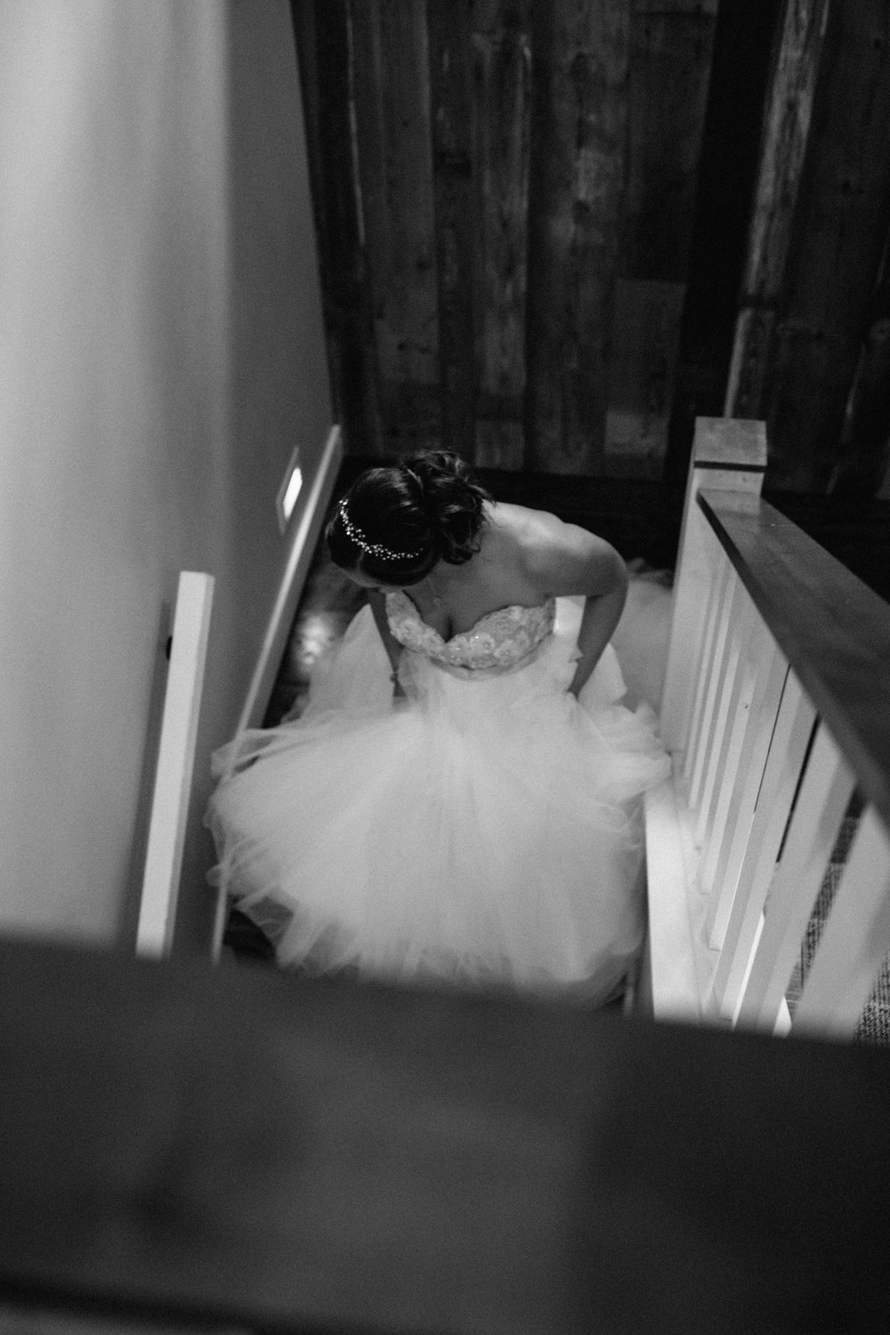 Bride walking down stairs in a stunning tulle wedding dress at Grand View Lodge in Nisswa Minnesota