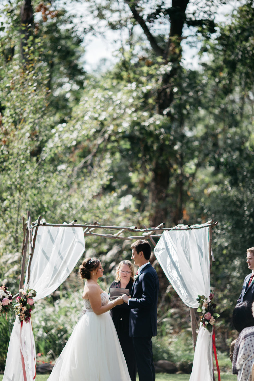Vineyard ceremony at Grand View Lodge. Photography by Britt DeZeeuw, Brainerd MN wedding photographer.