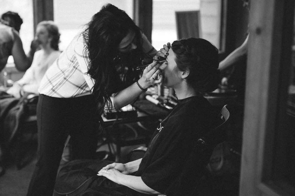 Bride getting ready on wedding day at Grand View Lodge in Nisswa Minnesota