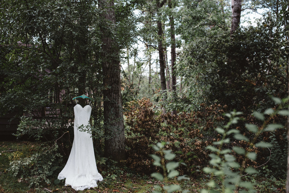 Lace wedding dress in the woods. Photograby by Brit DeZeeuw, Grand View Lodge wedding photographer
