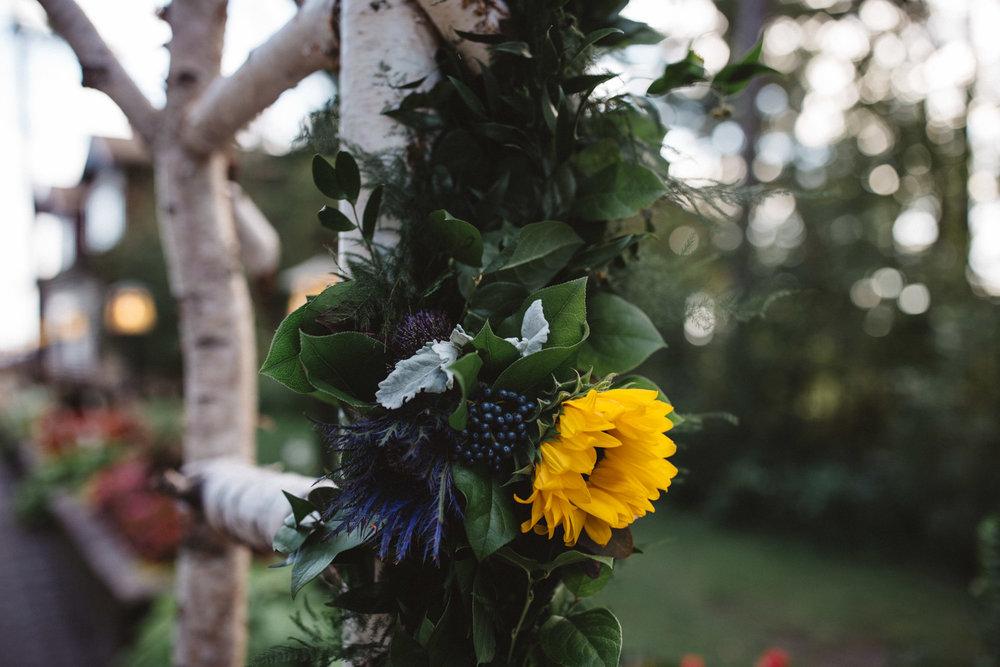 Floral arrangement by Bloom Designs. Wedding photography by Britt DeZeeuw, Grand View Lodge wedding photographer.