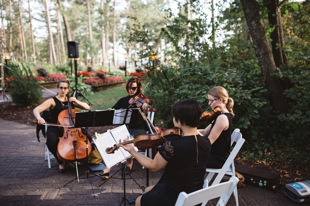 String quartet during ceremony at Grand View Lodge. Photography by Britt DeZeeuw, Brainerd Minnesota wedding photographer.